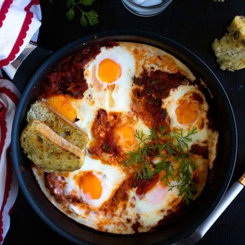 shakshuka poached eggs in spicy tomato sauce recipe video